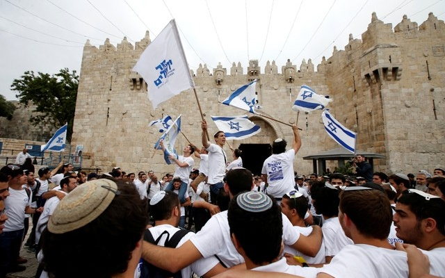 Israelis celebrate as they hold Israeli flags during a parade marking the annual Jerusalem Day, at Damascus Gate in Jerusalem's Old City, May 13, 2018. REUTERS