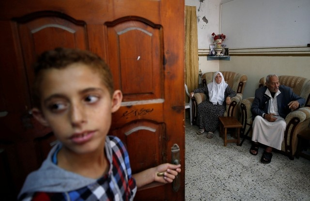 Palestinian refugees Saber Deeb and his wife Huda attend an interview with Reuters at their house in Gaza City May 9, 2018. Picture taken May 9, 2018. REUTERS