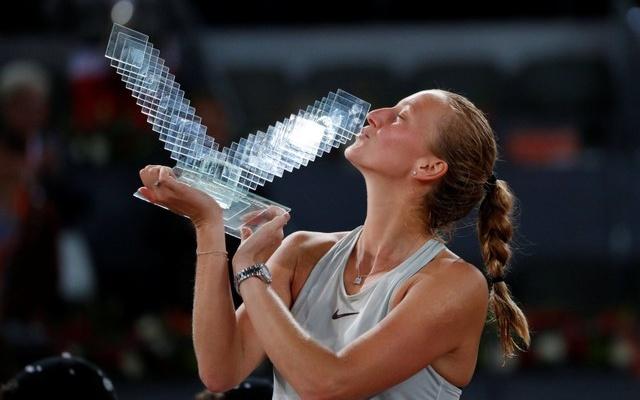 Czech Republic's Petra Kvitova celebrates with the trophy after winning the final against Netherlands' Kiki Bertens at Madrid Open in Spain on May 12, 2018. Reuters