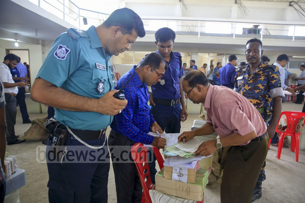 Security forces and election officials test the ballot papers. Photo: Mostafigur Rahman