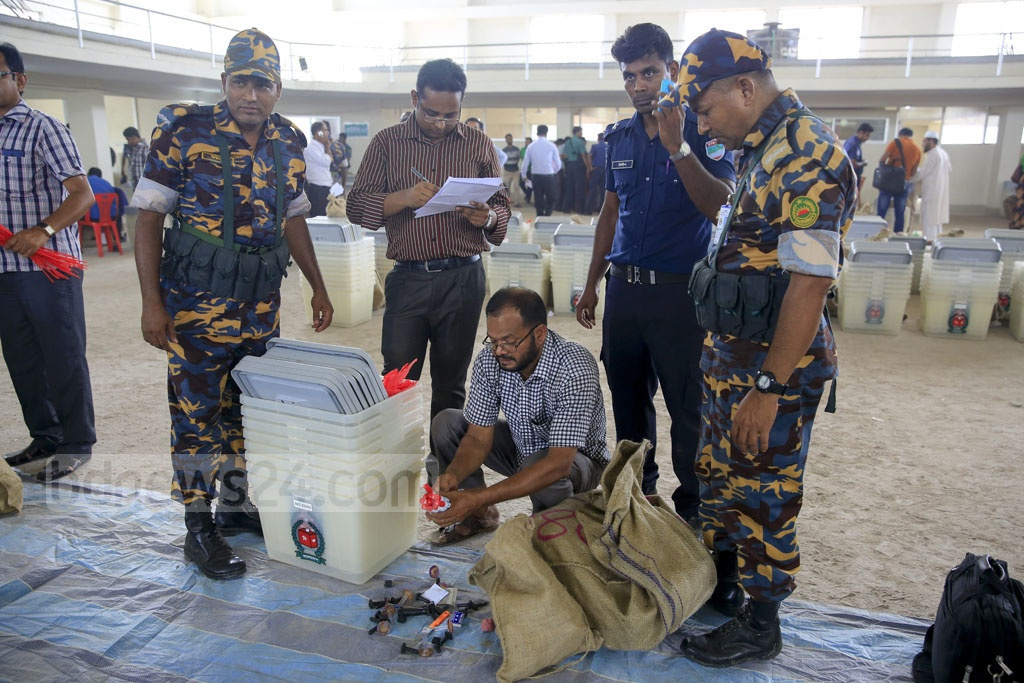 Seals and markers are put into sacks to be taken to the polling centres. Photo: Mostafigur Rahman