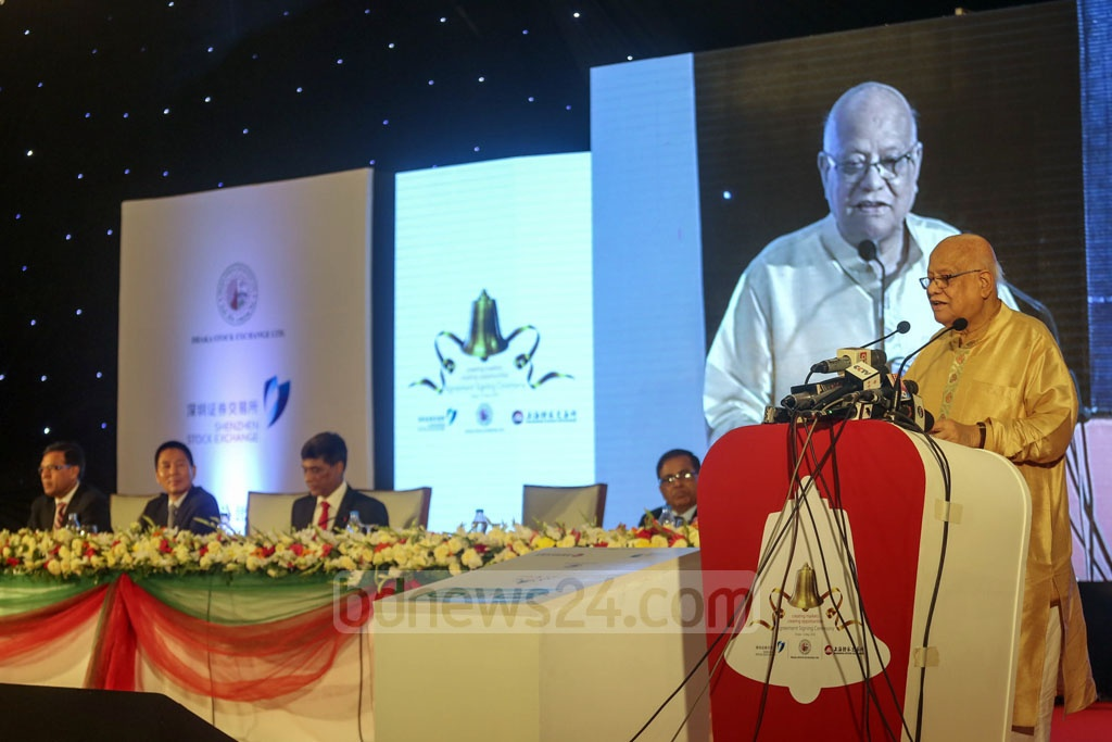 Finance Minister AMA Muhith speaks at the signing of an agreement between Dhaka Stock Exchange and a consortium of China's Shenzhen and Shanghai bourses on strategic partnership at a hotel in the capital on Monday.