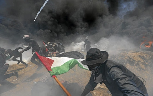 during a protest against US embassy move to Jerusalem and ahead of the 70th anniversary of Nakba, at the Israel-Gaza border, east of Gaza City May 14