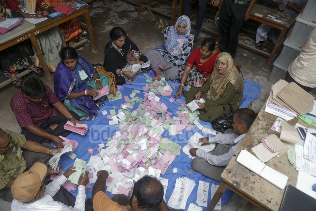 Officials count ballot papers after voting at Khulna City Corporation on Tuesday. Photo: Mostafigur Rahman