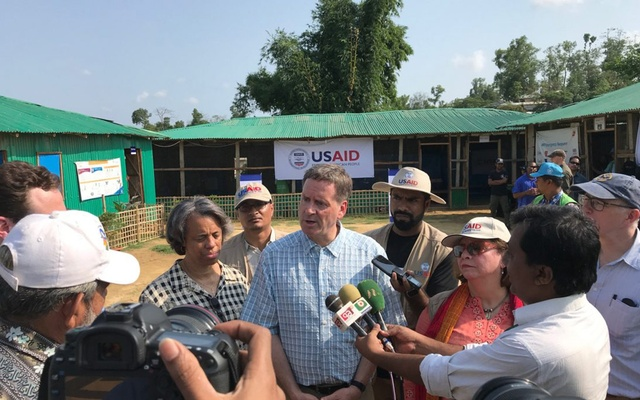 Visiting USAID Administrator Mark Green (center) with US Ambassador to Bangladesh Marcia Bernicat (on left) and USAID Bangladesh Mission Director Janina Jaruzelski (on right) speaks to reporters at Balukhali Rohingya refugee camp in Cox's Bazar.