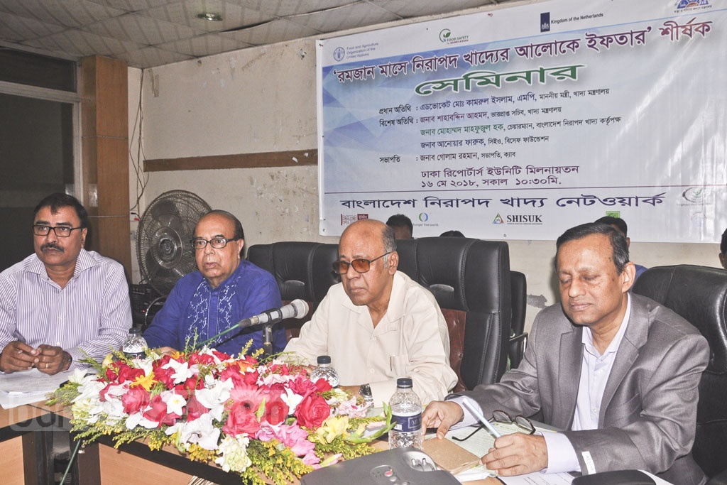 Food Minister Qamrul Islam addresses a seminar arranged by Bangladesh Food Safety Network at the Dhaka Reporters Unity on Wednesday.