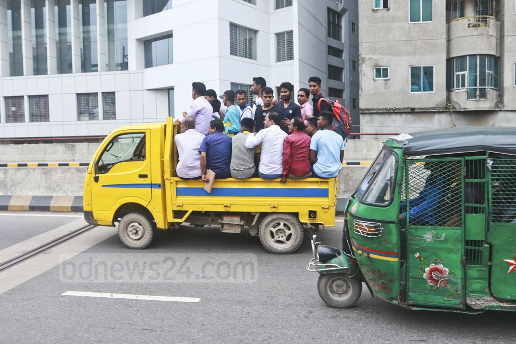 Heavy traffic jam on the Dhaka-Chattogram highway and a shortage of public transports force many commuters to use pick-up vans to reach their destinations. The photo was taken from Mayor Hanif Flyover on Wednesday. Photo: Abdullah Al Momin