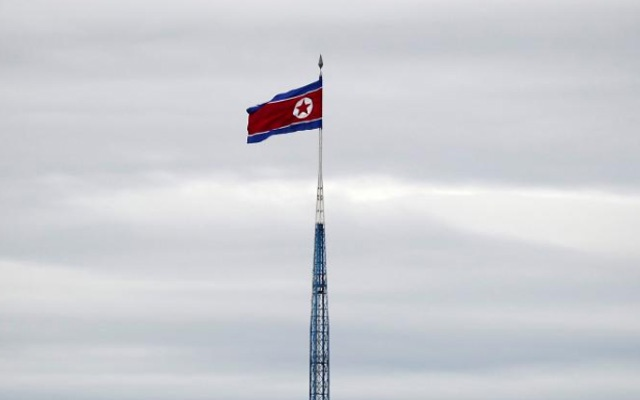 FILE PHOTO: North Korean flag flutters on top of a 160-metre tower in North Korea's propaganda village of Gijungdong, in this picture taken from the Tae Sung freedom village near the Military Demarcation Line (MDL), inside the demilitarised zone separating the two Koreas, in Paju, South Korea, Apr 24, 2018. REUTERS/Kim Hong-Ji