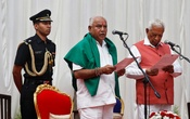 India's ruling Bharatiya Janata Party (BJP) leader BS Yeddyurappa is administered the oath as Chief Minister of the southern state of Karnataka by Governor Vajubhai Vala inside the Governor's house in Bengaluru, India, May 17, 2018. Reuters