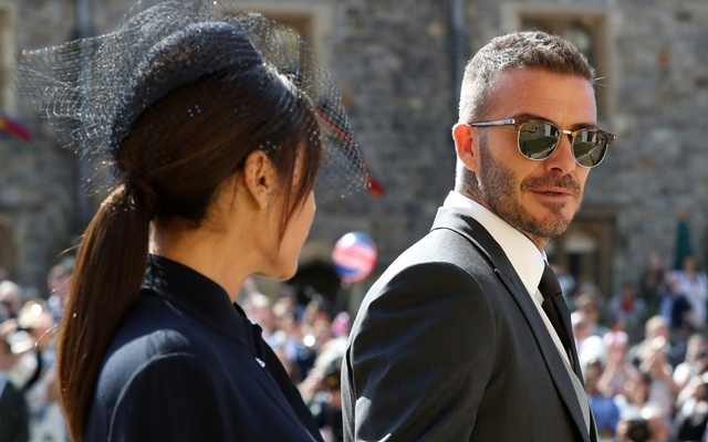 David Beckham and Victoria Beckham arrive at St George's Chapel at Windsor Castle for the wedding of Meghan Markle and Prince Harry in Windsor, Britain, May 19, 2018. Reuters