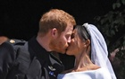 Prince Harry and Meghan Markle kiss on the steps of St George's Chapel in Windsor Castle after their wedding in Windsor, Britain, May 19, 2018. REUTERS