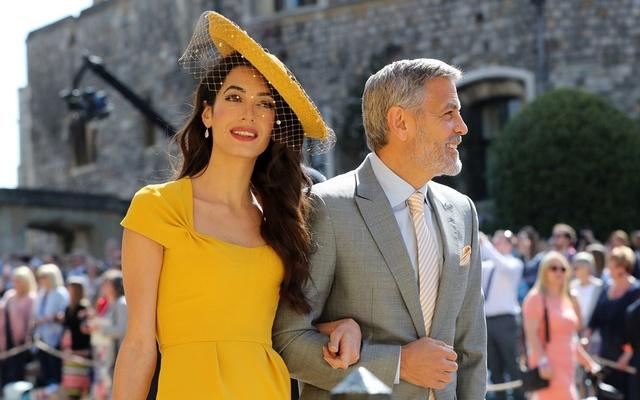 Amal Clooney and George Clooney arrive at St George's Chapel at Windsor Castle for the wedding of Meghan Markle and Prince Harry. Saturday May 19, 2018. Gareth Fuller/Pool via REUTERS
