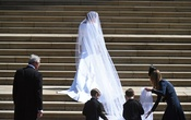 Meghan Markle arrives at St George's Chapel in Windsor Castle for her royal wedding ceremony to Britain's Prince Harry, in Windsor, Britain, 19 May 2018. NEIL HALL/Pool via REUTERS