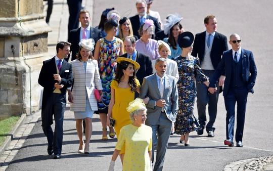 US actor George Clooney and his wife, lawyer Amal Clooney arrive with guests to the wedding of Britain's Prince Harry to Meghan Markle in Windsor, Britain, May 19, 2018. Reuters