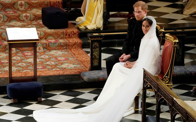 Prince Harry and Meghan Markle in St George's Chapel at Windsor Castle during their wedding service in Windsor, Britain, May 19, 2018. Owen Humphreys/Pool via REUTERS