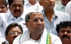 Outgoing Chief Minister of the southern state of Karnataka Siddaramaiah attends a protest against India's ruling Bharatiya Janata Party (BJP) leader BS Yeddyurappa's swearing-in as Chief Minister of the southern state of Karnataka, in Bengaluru, India, May 17, 2018. Reuters