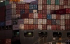 FILE PHOTO: The YM Bamboo, a container ship operated by the China Ocean Shipping Company (COSCO) is docked at the Port of Oakland in Oakland, California January 14, 2011. Reuters