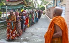 Muslims women line up for Iftar doles at a Buddhist Vihara in Dhaka's Basabo.
