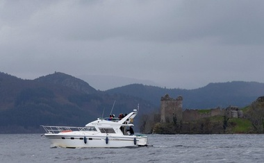 FILE PHOTO: A boat sails in front of Urquhart Castle on Loch Ness in Scotland, Britain April 13, 2016. Reuters