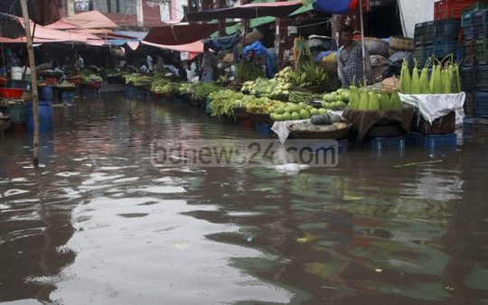 The capital's Karwan Bazar kitchen market goes under water on Wednesday after morning rains.