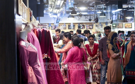 New cothes are making their way into the shopping hotspots in Dhaka and many have begun shopping for the Eid. A sizable crowd was spotted at the Bashundhara City shopping Mall on Friday. Photo: Mahmud Zaman Ovi