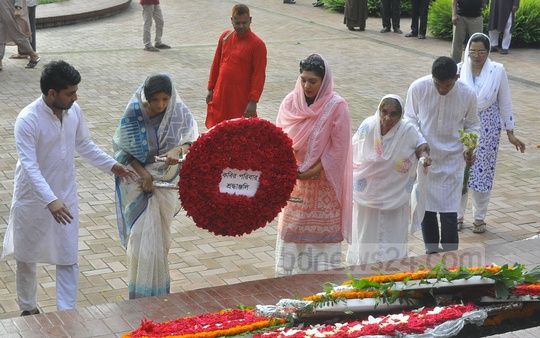 Descendants and relatives of National Poet Kazi Nazrul Islam offering floral tributes to him at his grave on his 119th birth anniversary on Friday.