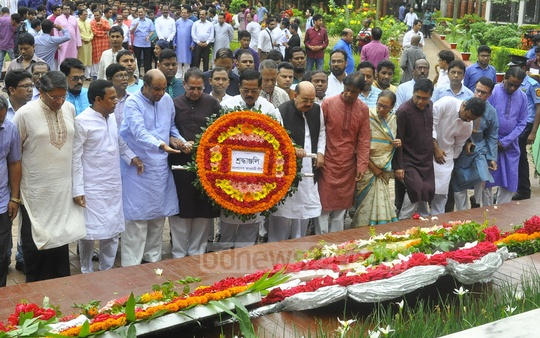 The Awami League led by Jahangir Kabir Nanak pays its respect to National Poet Kazi Nazrul Islam by placing a floral wreath at his grave on his 119th birth anniversary on Friday.