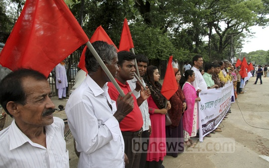 The Bangladesh Garment Workers Union Council holds a demonstration in front of the National Press Club to demand that all back pay and Eid bonuses owed to workers be paid by the 20th of Ramadan.
