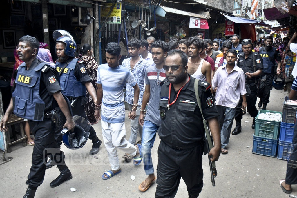 The Rapid Action Battalion or RAB detained a number of suspects during a raid on the Stranded Pakistanis Relief Camp, popularly known as the Geneva Camp, in Dhaka's Mohammadpur on Saturday as a part of a nationwide war on drugs.