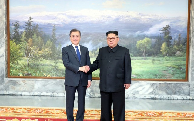 South Korean President Moon Jae-in shakes hands with North Korean leader Kim Jong Un during their summit at the truce village of Panmunjom, North Korea, in this handout picture provided by the Presidential Blue House on May 26, 2018. The Presidential Blue House /Handout via Reuters