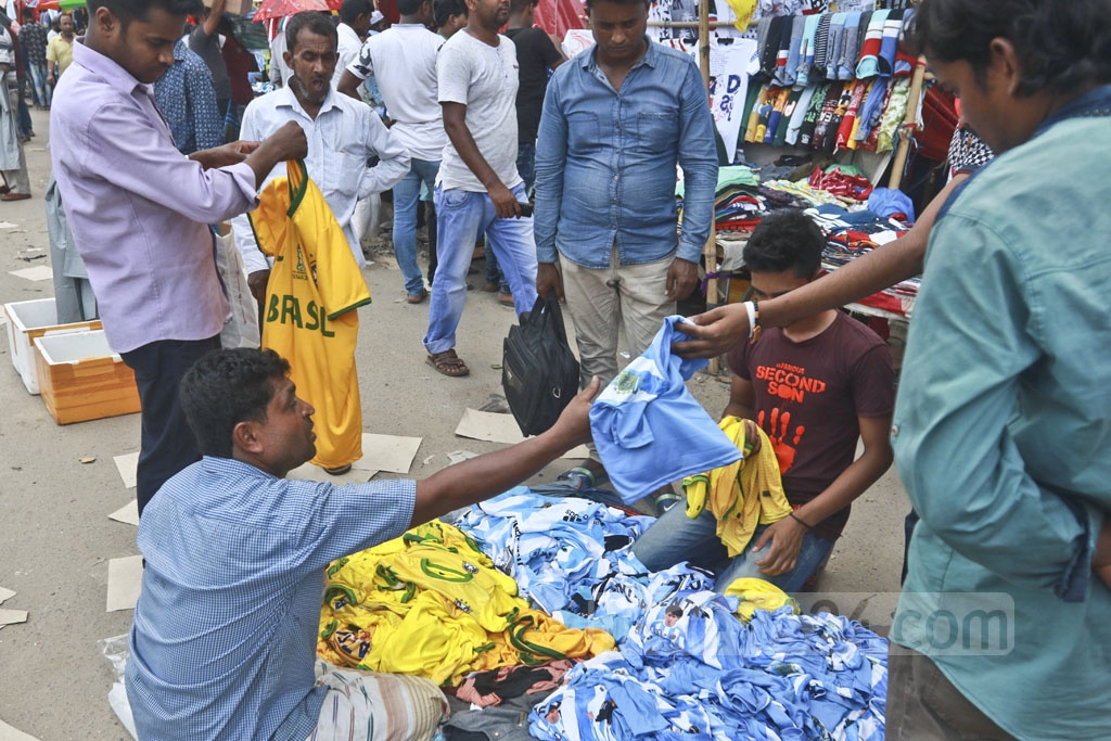 A trader sells football jerseys on the footpath in Dhaka. Photo: Abdullah Al Momin
