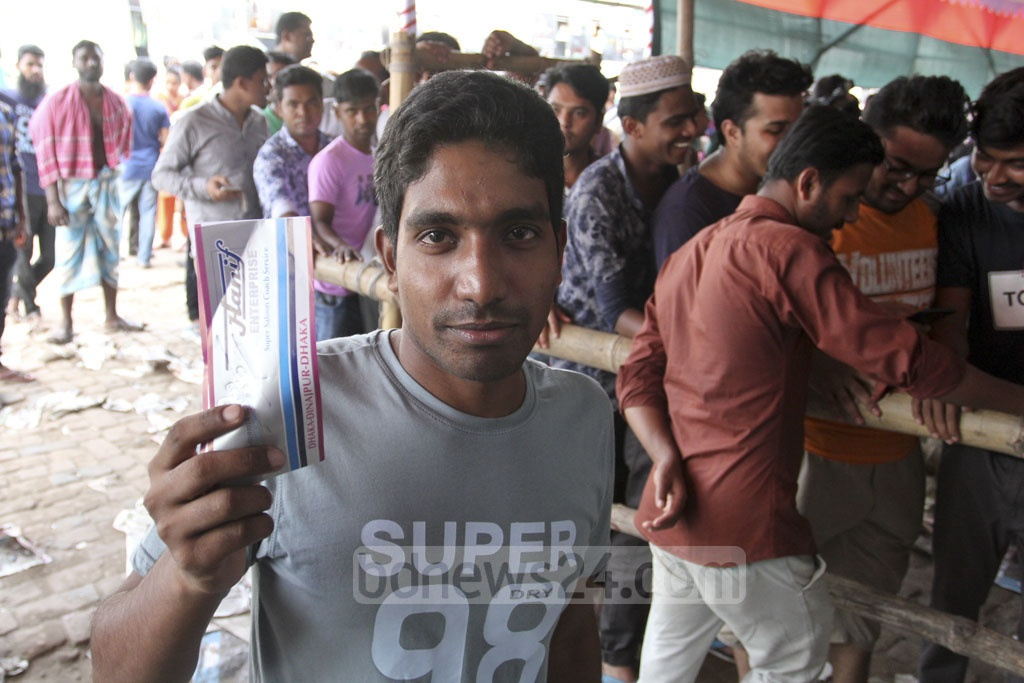 A man displays a bus ticket. Advance bus-ticket sale starts at the Gabtoli bus terminal in Dhaka on Wednesday. Photo: Asif Mahmud Ove