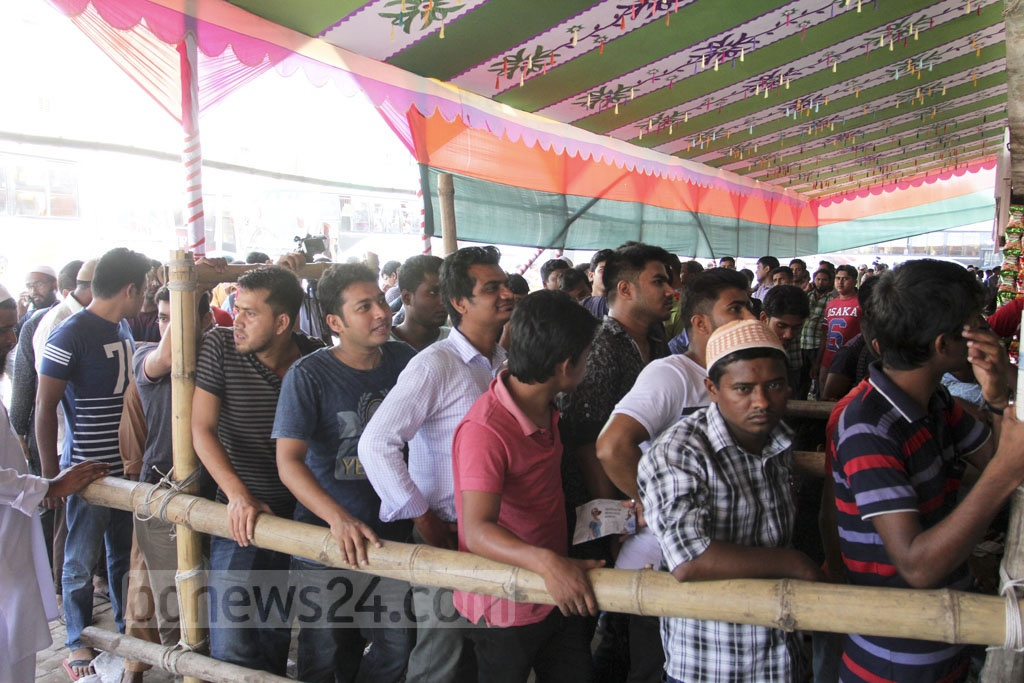 People line up to buy advance bus tickets ahead of their Eid travels. The picture was taken at the Gabtoli bus terminal on Wednesday. Photo: Asif Mahmud Ove