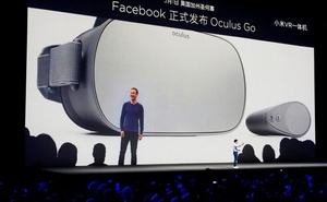 A screen showing Facebook founder Mark Zuckerberg as Xiaomi founder Lei Jun introduces a new VR headset during a product launch in Shenzhen, China May 31, 2018. Reuters