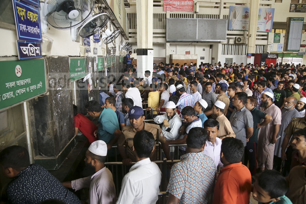 The Kamalapur Railway Station on Friday turns into a hotspot of milling crowds who waited for hours to buy advance train tickets for their journey home during Eid holidays. Photo: Mahmud Zaman Ovi