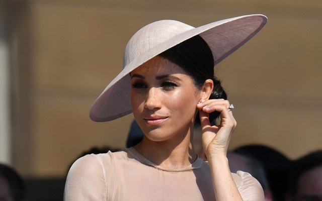 Meghan, Duchess of Sussex attends a garden party at Buckingham Palace, in London, Britain May 22, 2018. Dominic Lipinski/Pool via Reuters
