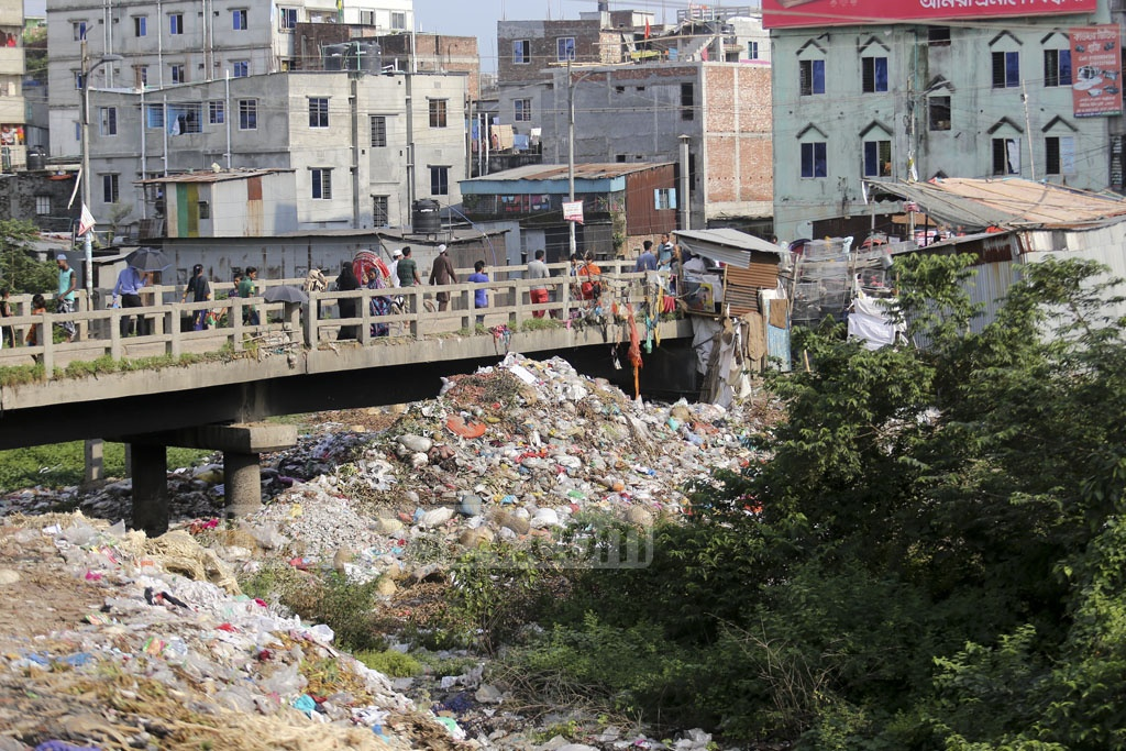A branch of the Buriganga which once flowed through Lalbagh, Companyghat, and Jhaauchor and rejoined the river behind Sikder Medical College has become a dumping ground. The photo is taken from Rasulpur on Saturday. Photo: Mahmud Zaman Ovi