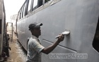 Representational Image: A man paints a bus at Dhaka's Gabtoli, June 3, 2018. Photo: Asif Mahmud Ove