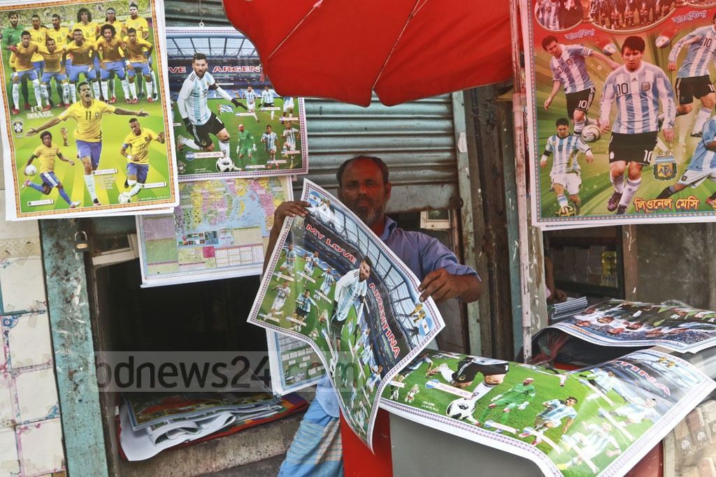 A trader sells pictures of star footballers ahead of the FIFA World Cup at Banglabazar on Monday. Photo: Abdullah Al Momin