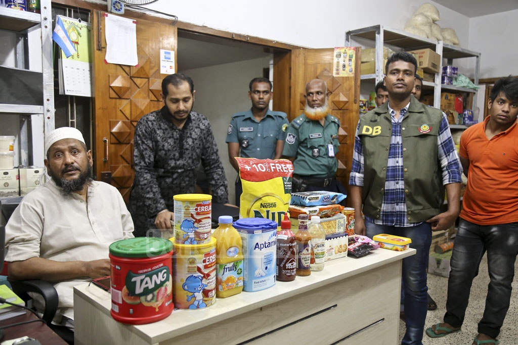 A police mobile court fined food importer Mawla Traders at Gulshan in Dhaka on Wednesday for storing expired products and items without BSTI clearance at its warehouse. Photo: Mahmud Zaman Ovi