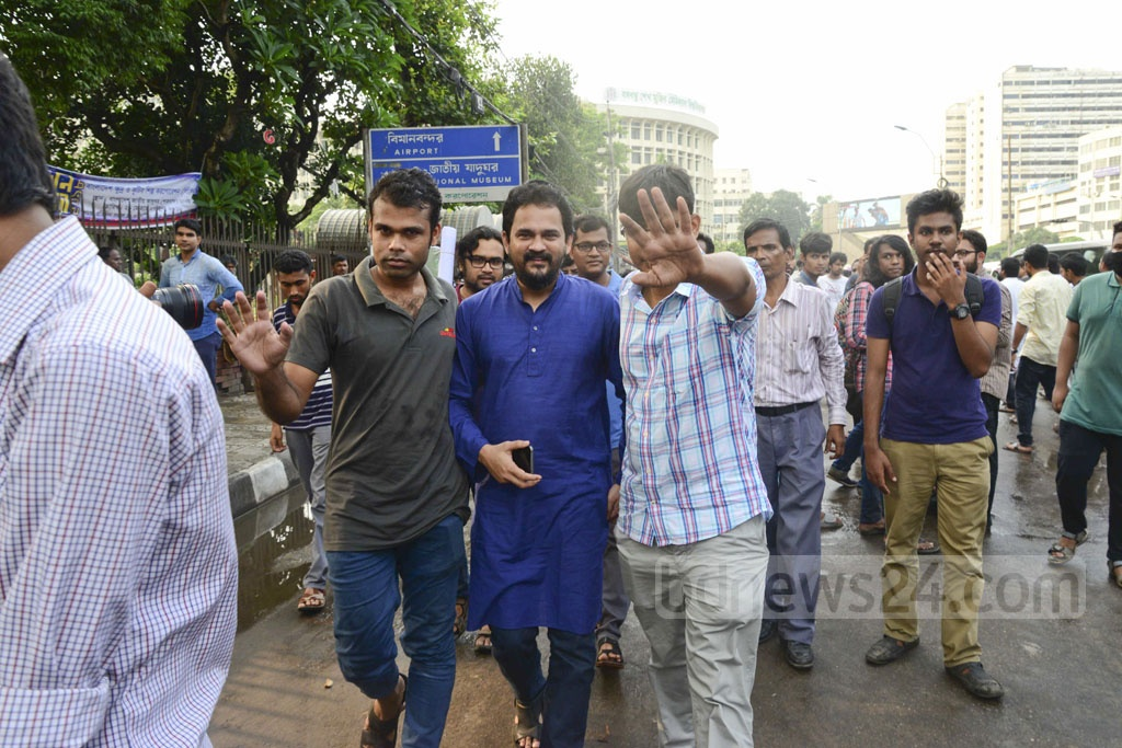 The Rapid Action Battalion detains Ganajagaran Mancha Spokesperson Imran H Sarker as he comes to Shahbagh in Dhaka to attend a rally against 'extrajudicial killings' during anti-drug operations.
