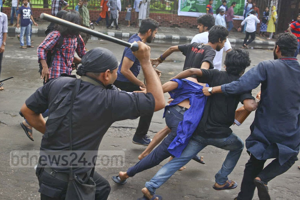 RAB personnel disperse activists by charging baton at Shahbagh in Dhaka on Wednesday after the elite force detained Ganajagaran Mancha Spokesperson Imran H Sarker from a protest rally against 'extrajudicial killings' during anti-drug operations.