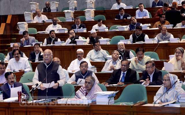 File Photo: Finance Minister AMA Muhith presenting the national budget for Fiscal Year 2018-19 in parliament. Photo: PID