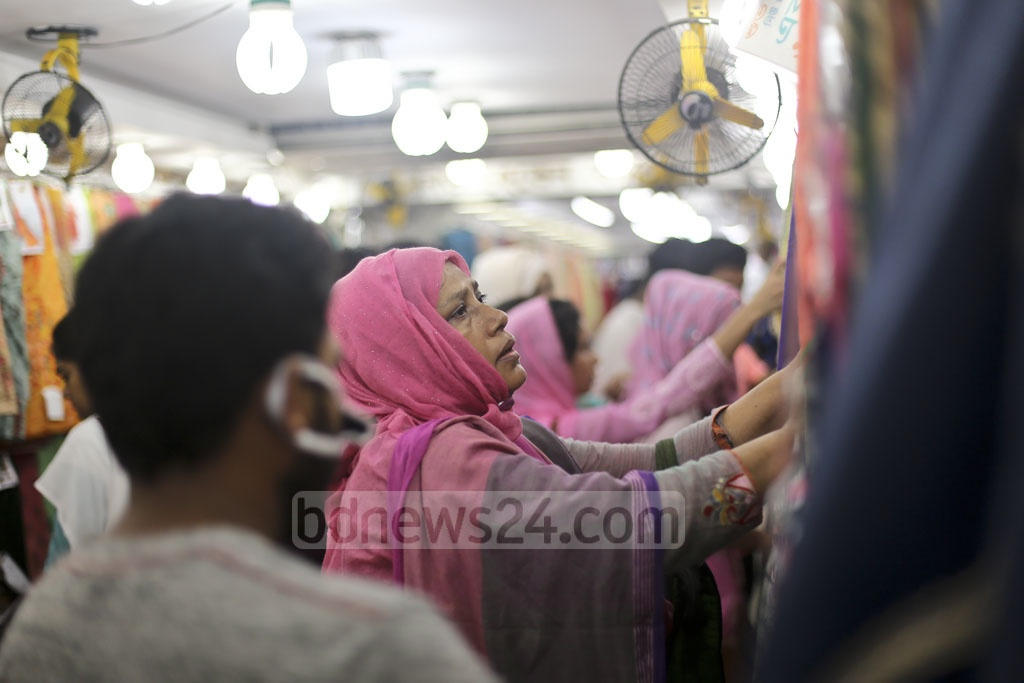 Eid shoppers flock to Gausia, Chandni Chowk, and New Market areas and Bashundhara City shopping complex on the weekend. The photo shows Gausia on Friday. Photo: Mahmud Zaman Ovi