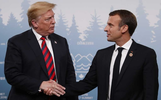 US President Donald Trump shakes hands with France's President Emmanuel Macron during a bilateral meeting at the G7 Summit in in Charlevoix, Quebec, Canada, Jun 8, 2018. Reuters