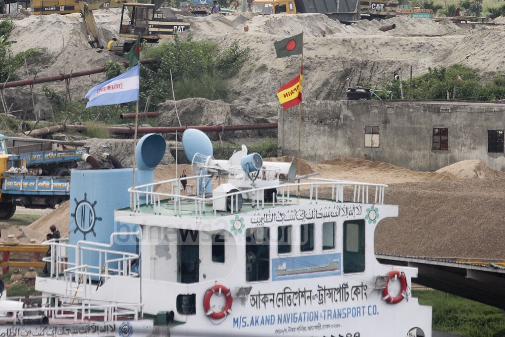 The flags of Argentina and Spain fly on a cargo vessel docked on the Turag River in Aminbazar. Photo: Asif Mahmud Ove