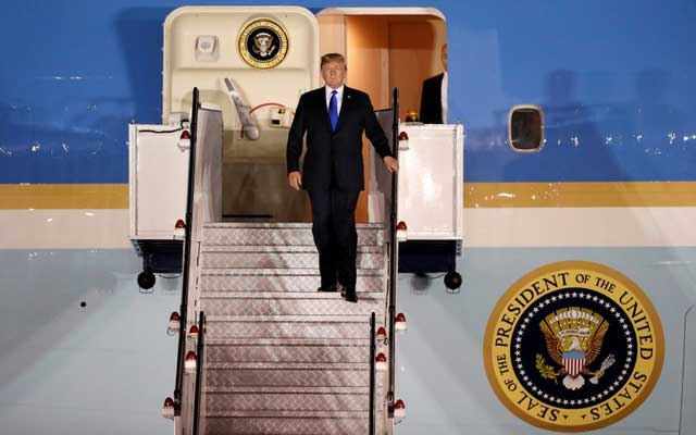 US President Donald Trump steps off his plane as he arrives at Paya Lebar Air Base in Singapore, ahead of a summit with North Korean leader Kim Jong Un, June 10, 2018.