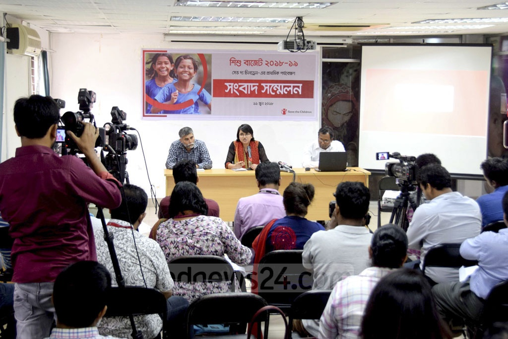 Save the Children officials react to the government allocations for children in the national budget in Dhaka on Monday