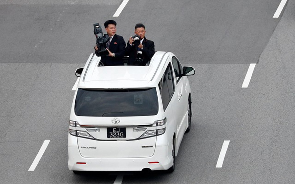 Official cameramen follow the motorcade of North Korean leader Kim Jong Un travels towards Sentosa for his meeting with US President Donald Trump, in Singapore June 12, 2018. Reuters
