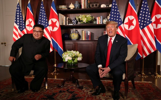 US President Donald Trump sits next to North Korea's leader Kim Jong Un before their bilateral meeting at the Capella Hotel on Sentosa island in Singapore June 12, 2018. Reuters